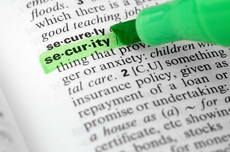 Close Up of Highlighting Specific Word Security in a Dictionary Stock Photo