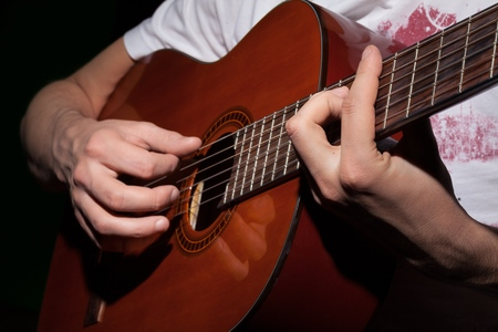 Man Playing Acoustic Guitar, Close-up, Isolated