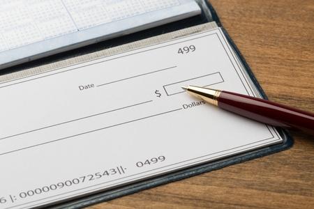 Chequebook & pen Stock Photo