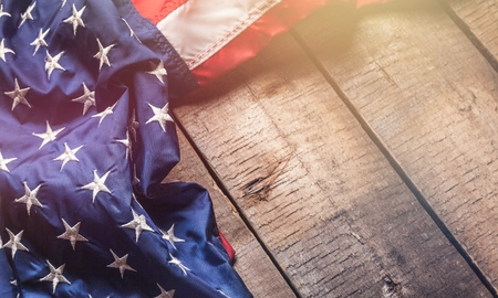 USA Flag on brown wooden board Stock Photo