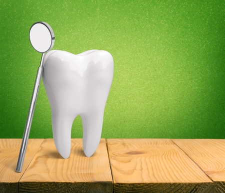 Tooth on white table Stock Photo