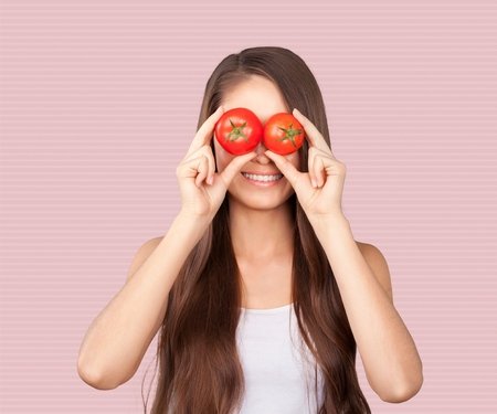 Woman with tomato eyes Imagens