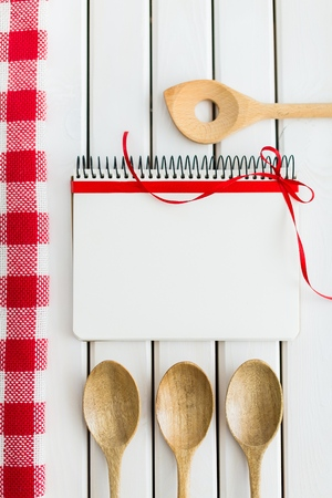 Notebook and Wooden Spoons