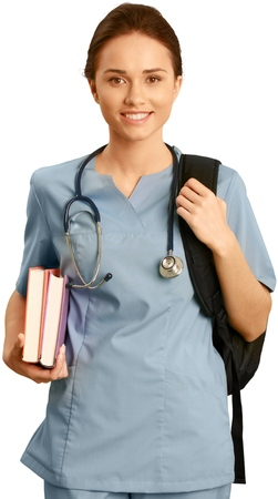 Female healthcare worker wearing scrubs and carrying textbooks and a backpack