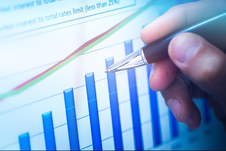 Businessman using Analytics chart