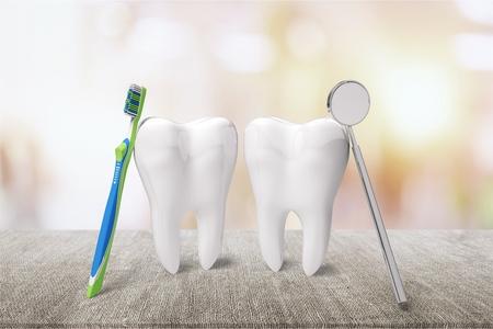 Big teeth, toothbrush and dentist mirror