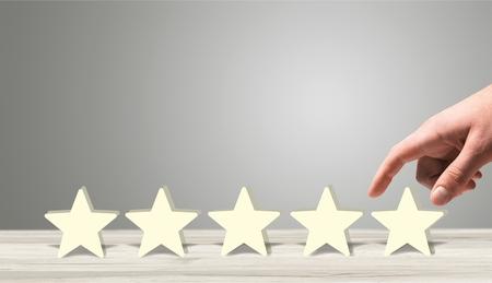 Hand putting wooden five star shape Standard-Bild