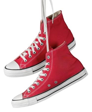 Paar hängende rote Schuhe Standard-Bild