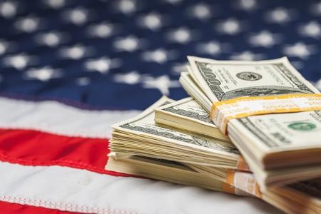 Dollar Bills on American Flag