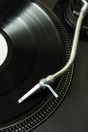 Black Gramophone Playing the Vinyl - Close Up