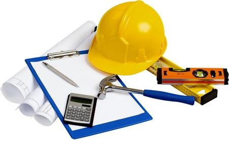 Construction Plans, Safety Helmet, Levels, Hammer, Pen, Calculator And Notepad - Isolated Reklamní fotografie
