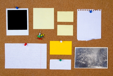 Bulletin board with with blank notes and a photograph