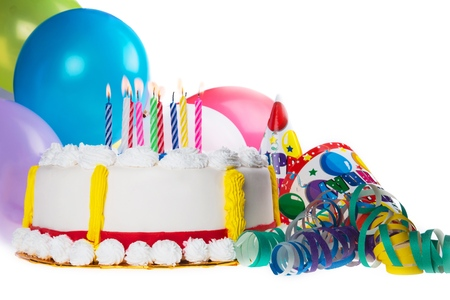 Decorative Birthday cake with candles and party favors Standard-Bild