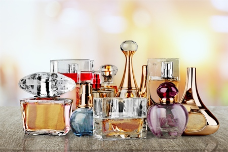 Aromatic Perfume bottles on background Archivio Fotografico