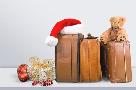 Retro large suitcases with Santa hat Stock Photo