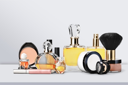 Aromatic Perfume bottles on background Foto de archivo