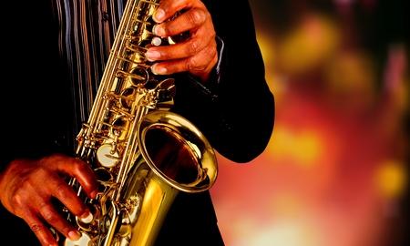 Saxophone player Saxophonist playing jazz music instrument Foto de archivo