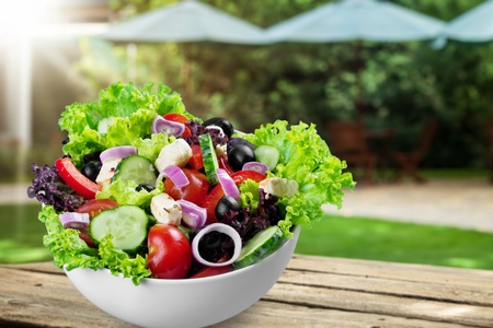 Close-up photo of fresh salad with vegetables