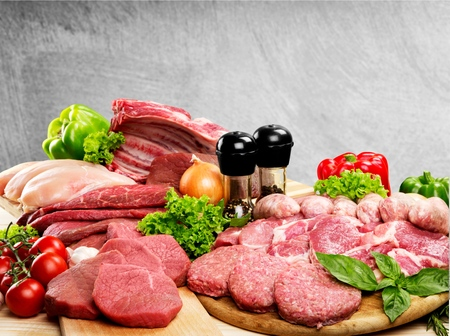 Fresh Raw Meat Background with vegetables Foto de archivo