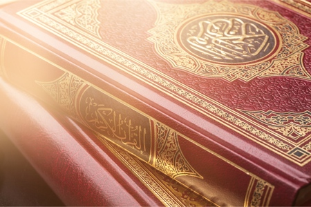 Islamic Book Koran with rosary on background