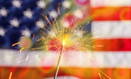 Sparkler and usa flag showing 4th of july Stock Photo