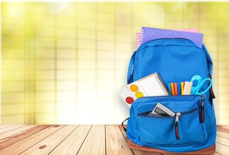 School bag on wooden desk