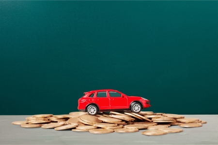 Golden coins and toy car