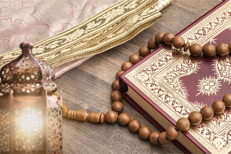 Holy Book Quran with rosary