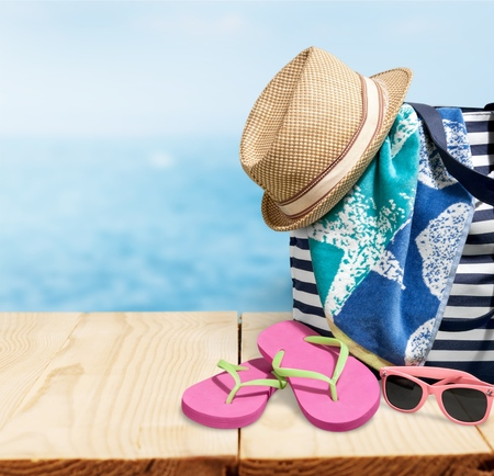 Suitcase of brown color on the beach Stock Photo