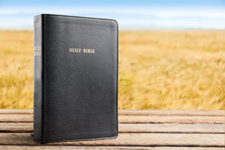 holy bible on wooden table