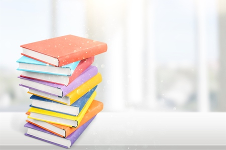 Colorful books collection on white table Stock Photo