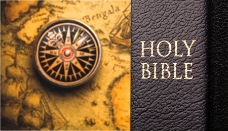 Retro compass and christianity black bible Stock Photo