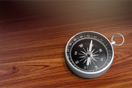 Compass on wooden table Stock Photo