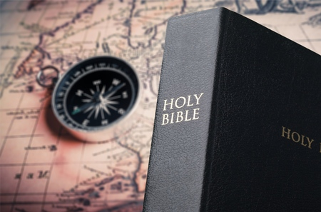 Holy Bible on map background