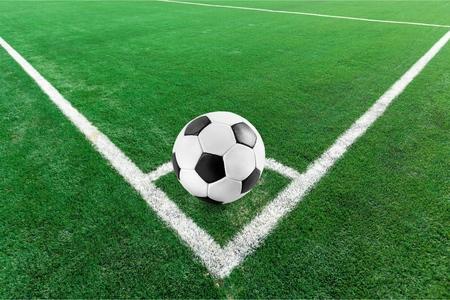 Football ball on grass Stock Photo
