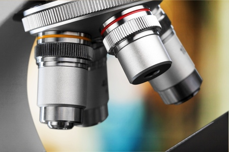 Microscope lenses on abstract background Stock Photo
