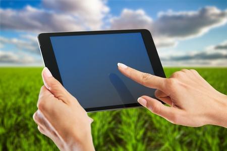 Female farmer using tablet computer Stock Photo