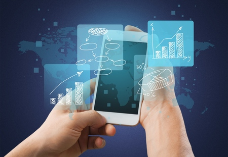 Hand using smartphone with financial tracking Stock Photo