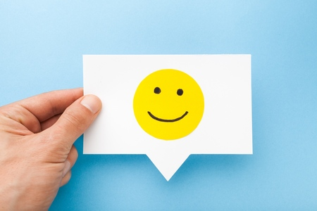 Happy face smiling comment on speech bubble Stock Photo