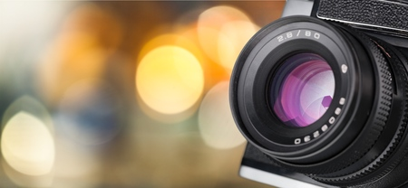 Camera lens with lense reflections on blur backgroun 版權商用圖片