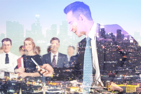 Business guy and team on city background