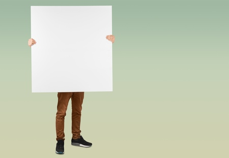 Man holding a blank poster Banque d'images - 119382463