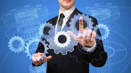 Businessman hand draws new technology concept