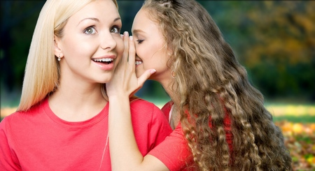 Two woman Whispering