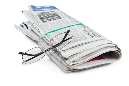 Stack of newspapers and eyeglasses on  background Stockfoto