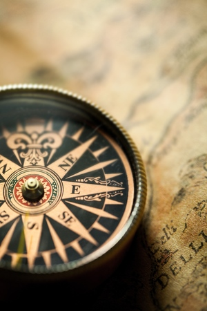 Closeup of an Old Compass on an Old Map