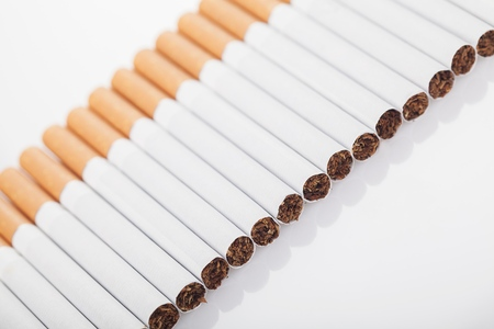 Row of cigarettes Stock Photo