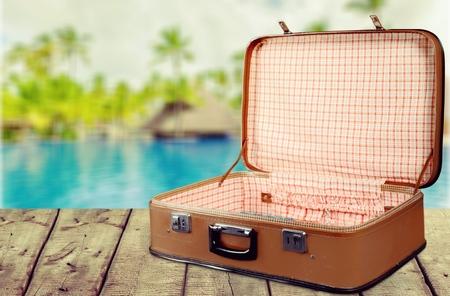 Vintage Suitcase on pool background