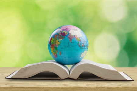 Ancient book and Earth globe Stock Photo