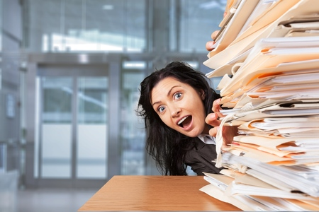 Office Worker Raises and stack paper Foto de archivo